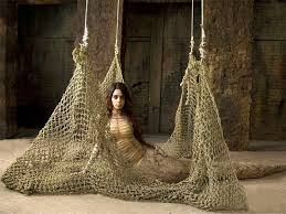 A female model sitting around a net