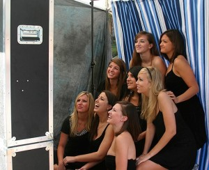 some women taking photo in photobooth